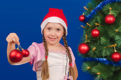 The girl holds New Year's toys in hand and smiles Royalty Free Stock Images