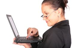 Girl  holds notebook and press key Stock Image