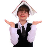 Girl holds the open book on a head Royalty Free Stock Photography