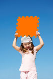 Girl holds orange poster Stock Photos