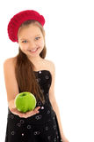 The girl holds out an Apple Royalty Free Stock Photos