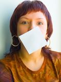The girl holds a paper. It is not cut out white square, and a leaf of a paper Royalty Free Stock Photography
