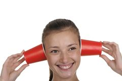 Girl holds a paper glass in a head Stock Image
