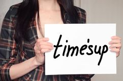 Girl holds a paper sheet with slogan time is up against harassment. And sexual discrimination Royalty Free Stock Photography