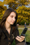 The girl holds phone Royalty Free Stock Photo