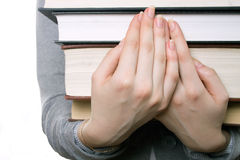 The girl holds a pile of books on hands Royalty Free Stock Photos