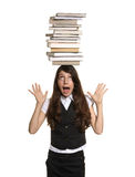 The girl holds pile of books on head. The girl holds a greater pile of books on a head Royalty Free Stock Photo