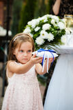 The girl holds a pillow with wedding rings Stock Photo