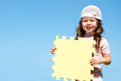 Girl holds a poster Royalty Free Stock Photography