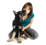 Girl holds the puppy in hands. The girl holds the puppy in hands Royalty Free Stock Photos