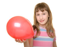 Girl holds red balloon on  hand Royalty Free Stock Image