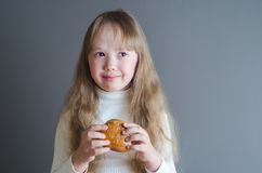 The girl holds a roll in hand Stock Image