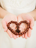 A girl holds a rosary in his hands Stock Photo