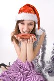 Girl holds a sausage Royalty Free Stock Photo
