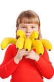 Girl holds a sheaf of bananas Stock Images