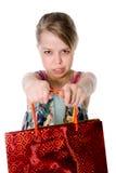 A girl holds a shopping bag. Stock Photos