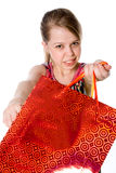 A girl holds a shopping bag. Royalty Free Stock Image