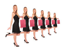 Girl holds small bag group Royalty Free Stock Image