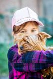 The girl holds a small dog breed Yorkshire Terrier on her hands_. The girl holds a small dog breed Yorkshire Terrier on her hands stock image