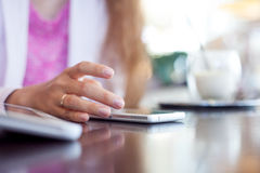 Girl holds a smartphone,  small depth of field Stock Photo