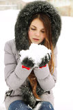 Girl holds snow Stock Image