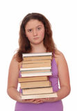 A girl holds a stack of books. Royalty Free Stock Photography