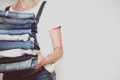 Jeans in her hands royalty free stock images