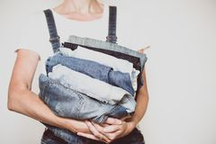 Jeans in her hands stock photography