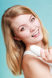 Girl holds stick deodorant in hand. Royalty Free Stock Photo