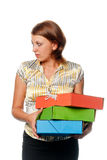 Girl holds three multi-coloured folders Royalty Free Stock Image