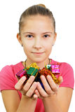 Girl holds tiny gifts Stock Photos