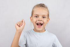 Girl holds the tooth in his hand and his mouth open showing a hole between the teeth Royalty Free Stock Images
