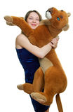 Girl holds the Toy animal Stock Images