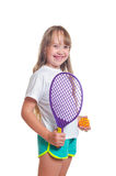 The girl holds a toy racket and a ball in hand Royalty Free Stock Images