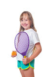 The girl holds a toy racket and a ball in hand Royalty Free Stock Photos