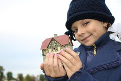 The girl holds a toy small house in a hand Stock Photo