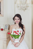 The girl holds tulips Royalty Free Stock Images
