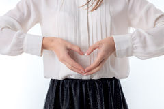 Girl holds two hands sweetheart isolated on white background. A girl holds two hands sweetheart isolated on white Royalty Free Stock Photo