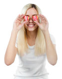 Girl holds two hearts before her eyes Stock Images