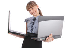 Girl holds two laptop Stock Images