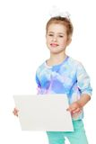 Girl holds up a sheet of paper Stock Photo