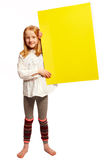 Girl holds up a sign at the side. Girl suggests decided on a plate royalty free stock image