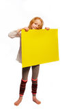 Girl holds up a sign. Girl suggests decided on a plate stock photography