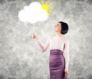 Girl with cloud. Girl holds a white cloud in a hand Stock Photography