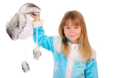 Girl holds winter fur cap Stock Images