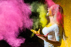 Girl with holi paints. Portrait of a beautiful female with holi paint royalty free stock images