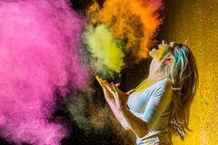 Girl with holi paints. Portrait of a beautiful female with holi paint stock photography