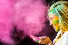 Girl with holi paints Stock Image
