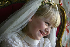 Girl in Holy Communion dress Royalty Free Stock Images