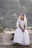 Girl in holy communion dress. Girl celebrating her first communion royalty free stock photography